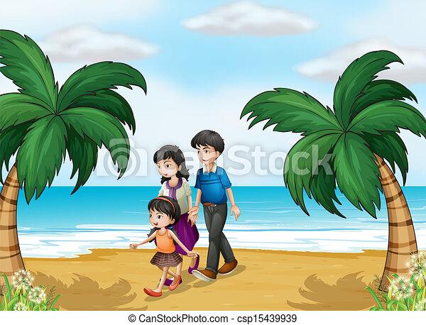 Eine Familie, die am Strand spazieren geht - csp15439939