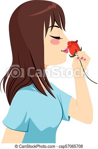 Eine Frau, die Rose riecht. - csp57065708