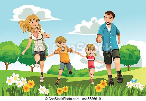 Familie läuft im Park - csp8536619