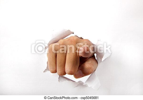 Hand brechen durch das weiße Papier mit dem Finger auf dich. - csp5045681