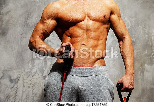 Schöner Mann mit Muskelkraft. - csp17254759